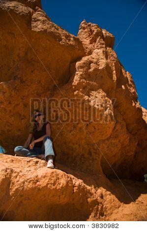 Woman Posing Under Rock
