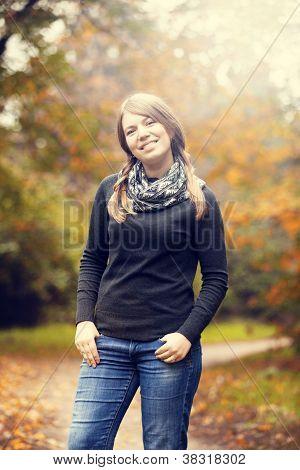 Beautiful Girl At Autumn Park.