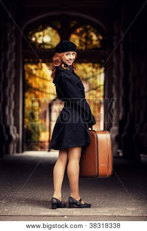 Style Redhead Girl With Bag At The Autumn Street.