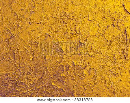Textur der alten Mauer mit einer gebrochenen goldenen Farbe.