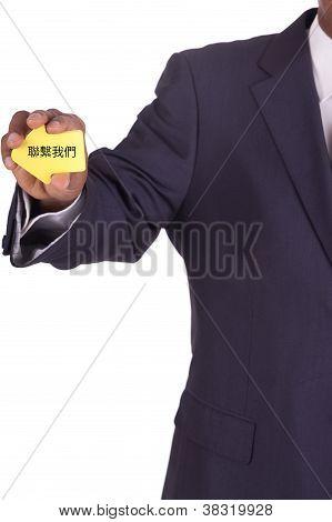 Businessman With A Notiz In Hand