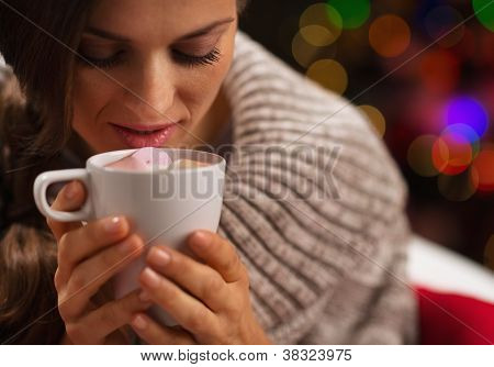 Young Woman Holding Cup Of Hot Chocolate With Marshmallows