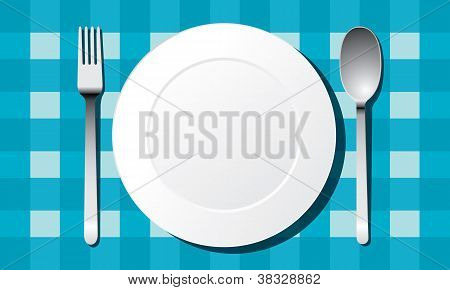 place setting. A white plate with silver fork and knife