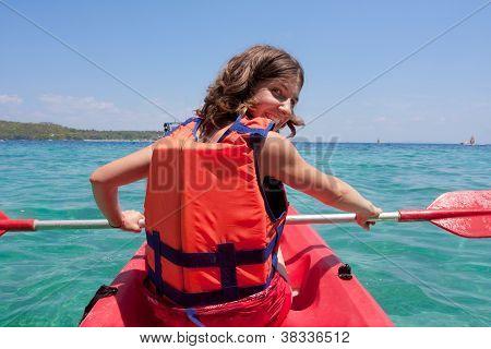 woman is kayaking