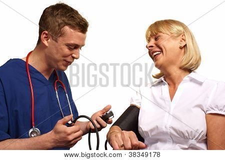 Doctor Checking Blood Pressure Of A Mature Female Patient