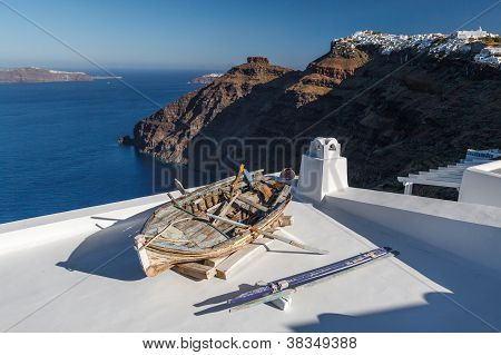 Old Fishing Boat On Terrace In Santorini Island