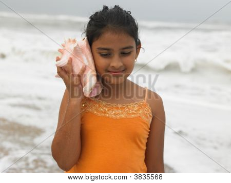Asian Girl Of Indian Origin Listening To A Conch