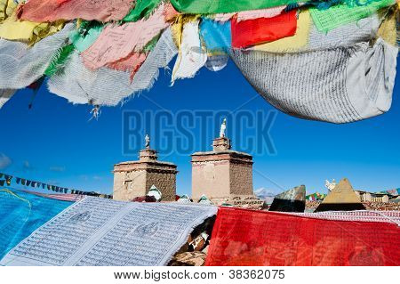 Prayer Flags Surround A Tibetan Monastery