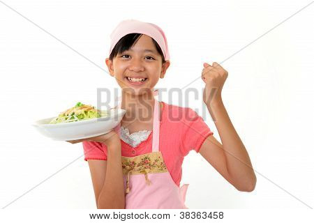 Smiling girl cooking