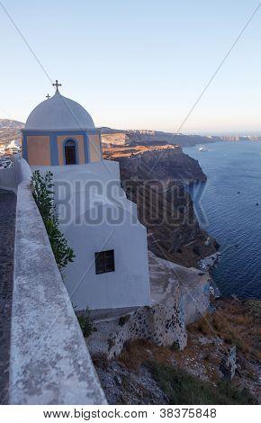 A Cliffside Chapel In Santorini, Greece.
