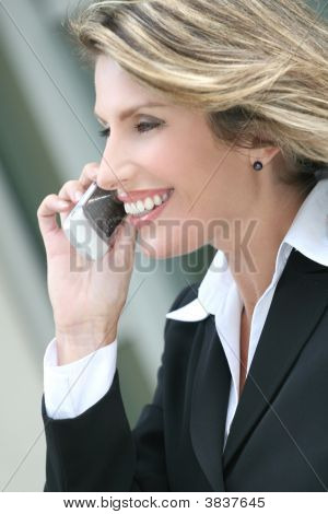 Headshot Of A Business, Corproate Woman, On Cellphone