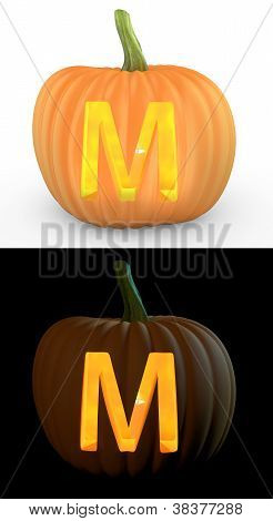 M Letter Carved On Pumpkin Jack Lantern