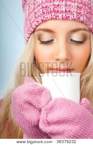woman holding cup of drink