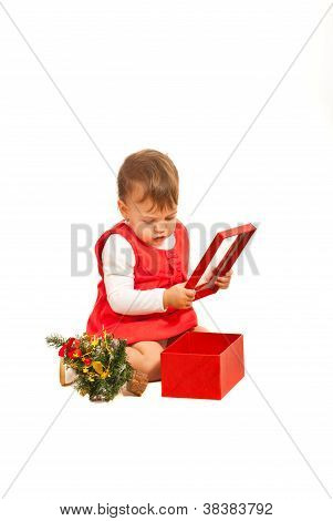 Toddler Girl Looking In Christmas Gift