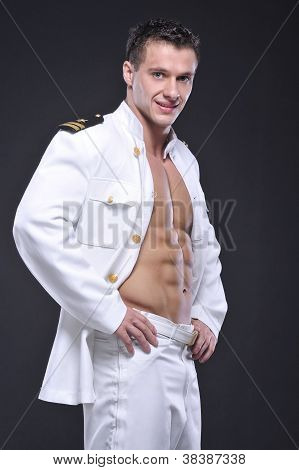 A Man Dressed As A Pilot On Grey Background
