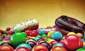 image of gumballs  - donuts and gumballs isolated on yellow background - JPG