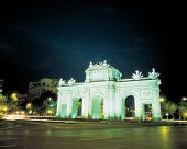 Arch Monument In Road Center At Night poster