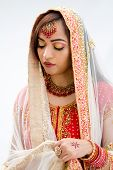 picture of bangla  - Elegant Bengali bride arranging veil looking down isolated - JPG