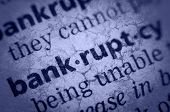 image of glossary  - the word bankruptcy in an English glossary super macro collage with grunge texture - JPG