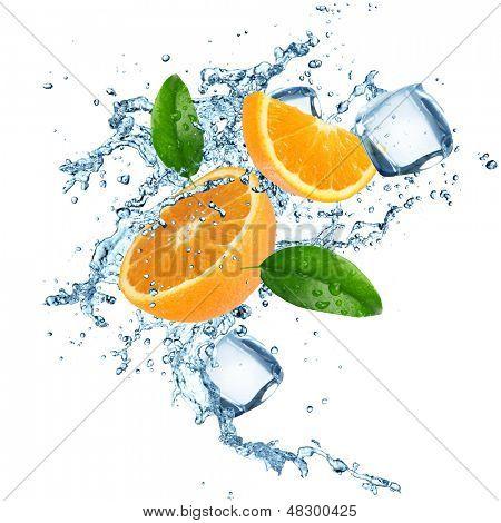 Fresh oranges in water splash. Isolated on white background.