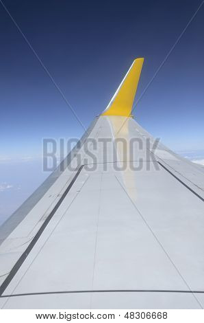 Wing Of Airplane Flying In The Sky