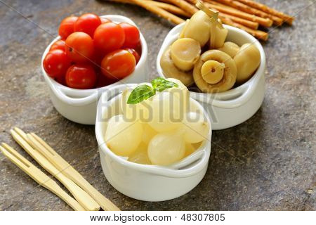 pickled snacks (tapas) - mushrooms, tomatoes, cucumbers and pearl onions