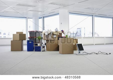 Cartons and equipment on floor of empty office space