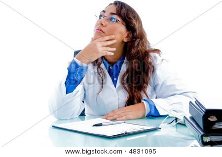 Portrait Of Female Doctor Looking Upside