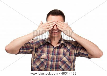 Man in plaid shirt covering his eyes