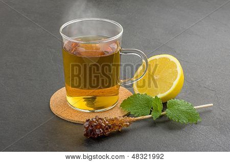 Steaming cup of tea on a slate plate