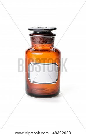 Apothecary bottle made of brown glass with empty label