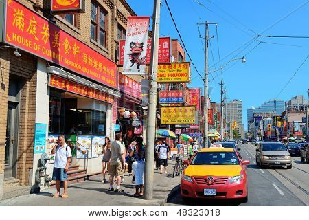 TORONTO, CANADA - JULY 2: Chinatown street view on July 2, 2012 in Toronto. It is one of the largest Chinatowns in North America and Chinese-Canadian Communities in Great Toronto Area.