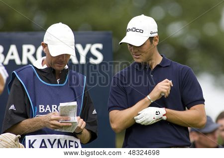 LOCH LOMOND, SCOTLAND - JUL 12 2009; Loch Lomond Scotland; Martin Kaymer (GER) and his caddy check their scorecard  competing in the final round of the PGA European Tour Barclays Scottish Open golf tournament.
