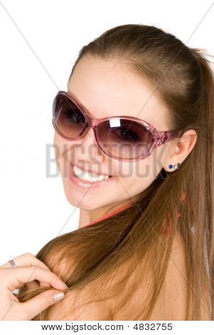 Close-up Portrait Of Smiling Young Beautiful Woman In Sunglasses