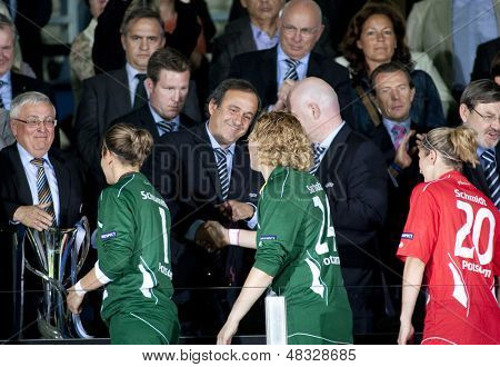 MADRID, SPAIN. 16/05/2010. Anna Felicitas Sarholz gets her winners medal from UEFA President Michel Platini at the Women's Champions League final  played in the Coliseum Alfonso Perez, Getafe, Madrid