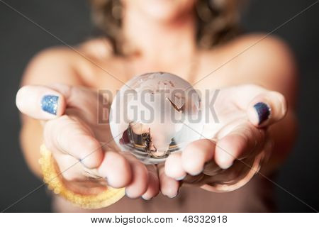 Caucasian Woman Holding Glass World Orb In Her Hands