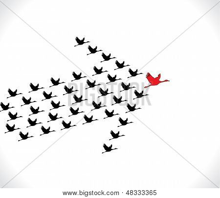 Leadership And Synergy Concept Illustration : A Number Of Swans Flying Against A Bright White Sky