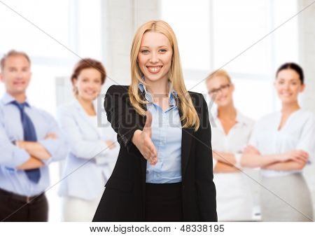 business concept - woman with an open hand ready for handshake
