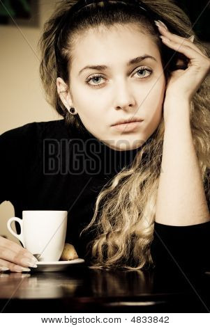 Beautiful Young Woman Portrait Holding A Cup Of Coffee