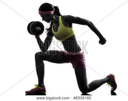 one caucasian woman exercising body builder weight training     in silhouette on white background