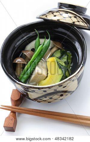 nimono, authentic japanese cuisine. simmered squash, freeze-dried bean curd, green beans, rotus roots, and brown beech mushroom