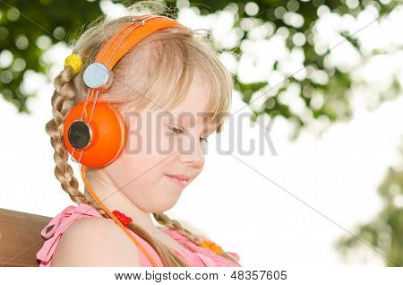 Girl Sitting On Bench In Park And Listening Language Audio Course