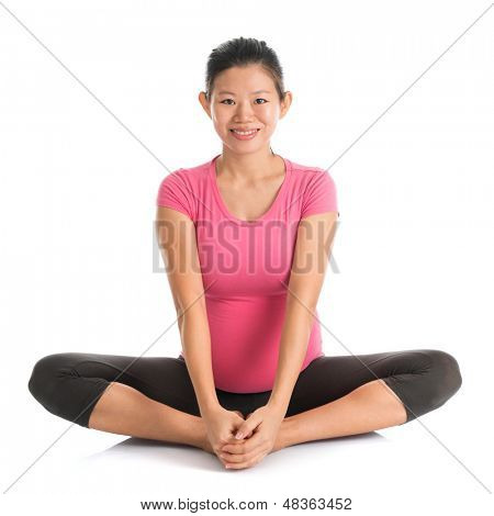 Prenatal yoga. Full length healthy Asian pregnant woman doing yoga exercising stretching, full body isolated on white background. Yoga butterfly pose.