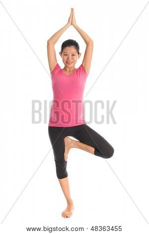 Prenatal yoga. Full length healthy Asian pregnant woman doing yoga exercise stretching at home, full body isolated on white background. Yoga positions standing tree pose.