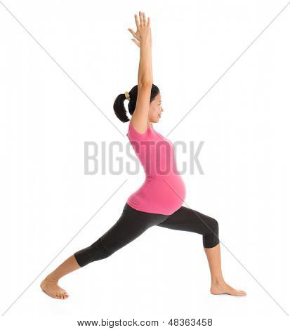 Prenatal yoga class. Full length healthy Asian pregnant woman doing yoga exercise stretching at home, full body isolated on white background. Yoga positions warrior pose 1.