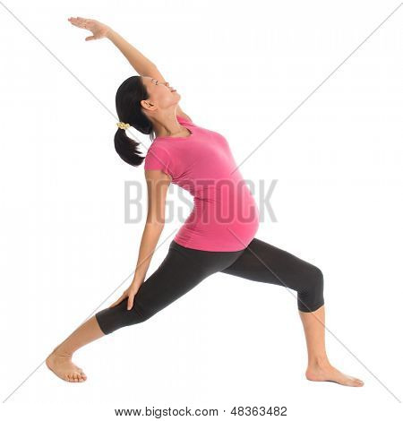 Prenatal yoga class. Full length healthy Asian pregnant woman doing yoga exercise stretching at home, full body isolated on white background.