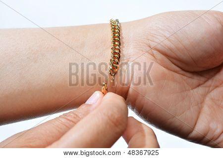 Wearing Gold Bracelet