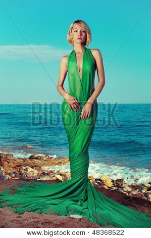 Beautiful nymph on the ocean. Fashion photo