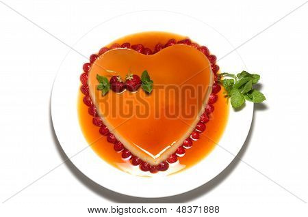 Heart Shape Flan Caramel With Strawberries And Mint Leaves