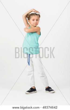 A girl is standing in a fighting stance with hands raised